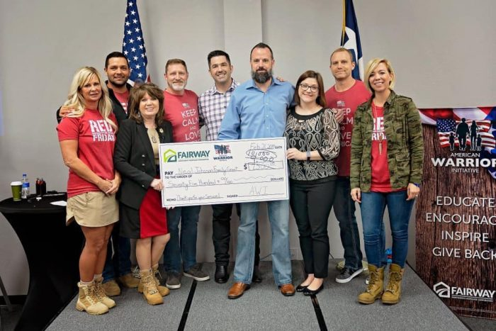 Fairway employees honor a Veteran with a large check